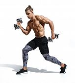 Sporty Man Training Muscles Of Hands And Legs Using A Dumbbells. Photo Of Young Man With Good Physiq poster