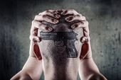Teenager with a picture of a gun superimposed on his head, concept of gun obsession poster