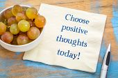 Choose positive thoughts today! Inspirational handwriting on napkin with fresh grapes. poster