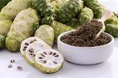Noni Fruit Or Morinda Citrifolia With Noni Slice And Noni Powder For Health On The White Background. poster