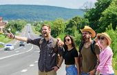 Friends Hitchhikers Looking For Transportation Sunny Day. Company Friends Travelers Hitchhiking At E poster