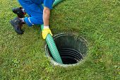 Emptying household septic tank. Cleaning sludge from septic system. poster