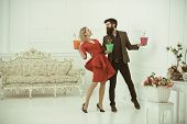 Floral Shop Concept. Couple In Floral Shop. Sensual Woman And Bearded Man In Floral Shop. Shopping F poster