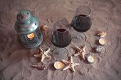 Romantic Beach Evening: Two Glasses Of Wine, Candles, Lantern, Shells, Starfishes. Valentines Day. poster