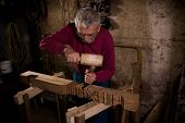 foto of woodcarving  - Old woodcarver work in the workshop 2 - JPG