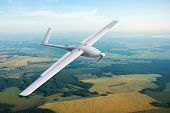 Unmanned Military Drone On Patrol Air Territory At Low Altitude. poster