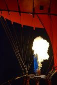 Hot Air Balloon With Burner By Night, Burner With A Extreme Hot Flame Light Up The Inside Of A Red H poster