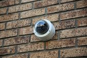 Security Camera. Security Camera attached to a wall of a building. Video Camera.  poster