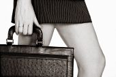 picture of short skirt  - businesswoman in short skirt holding a case - JPG