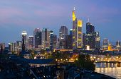 View Of Frankfurt Am Main Skyline At Dusk Along Main River With Cruise Ship In Frankfurt, Germany poster