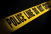 picture of crime scene  - Police Line Tape on a Black Background - JPG