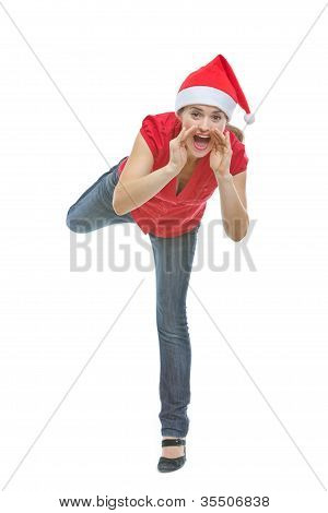 Cheerful Woman In Christmas Hat Shouting Through Megaphone Shape