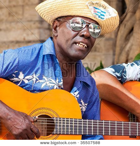 HAVANA-JULY 20:Unidentified musician playing typical songs for tourists July 20,2012 in Havana.The cuban music and culture is an attraction for more than 2 million people who visit Cuba every year