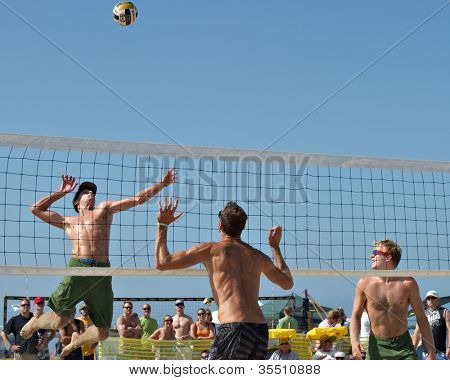 HERMOSA BEACH, CA - JULY 21: Will Montgomery, Jeremy Casebeer and Ryan Doherty compete in the Jose Cuervo Pro Beach Volleyball tournament in Hermosa Beach, CA on July 21, 2012.
