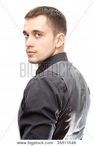 Portrait Of Young Confident Business Man Turning Round On White Background