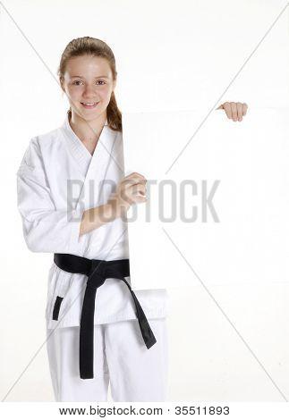 Постер, плакат: Боевых искусств девочка держит белый panel karate девушка портрет Холдинг группа Боевых искусств и каратэ, холст на подрамнике