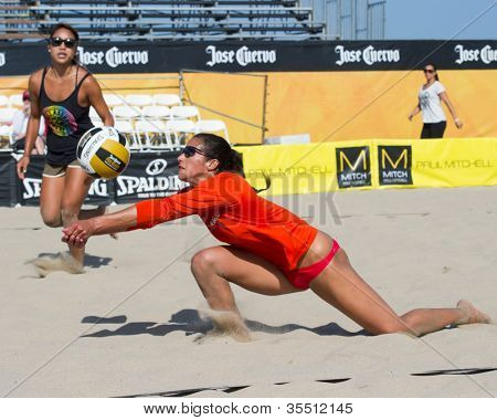 HERMOSA BEACH, CA - JULY 21: Lane Carico and Ashley Lee compete in the Jose Cuervo Pro Beach Volleyball tournament in Hermosa Beach, CA on July 21, 2012.