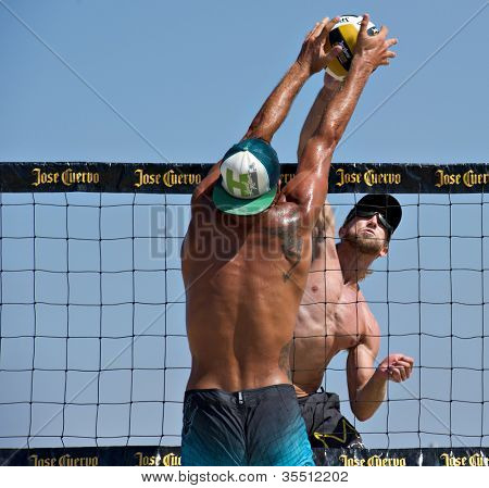 HERMOSA BEACH, CA - JULY 21: Ty Tramblie and Matt Motter compete in the Jose Cuervo Pro Beach Volleyball tournament in Hermosa Beach, CA on July 21, 2012.