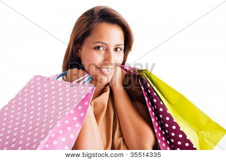 Closeup portrait of beautiful young woman holding shopping bags over white