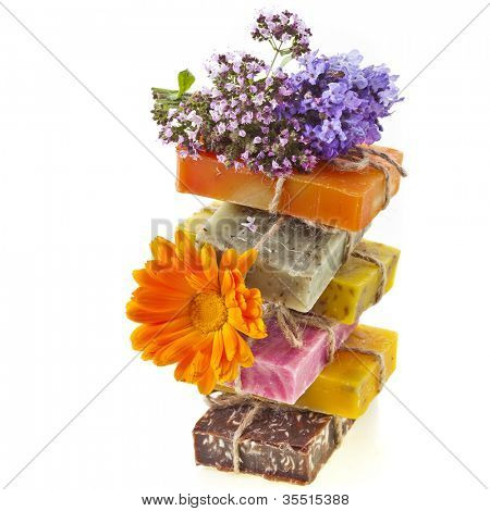 tower of handmade soaps isolated on white