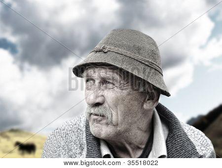 Elderly man's face over white background
