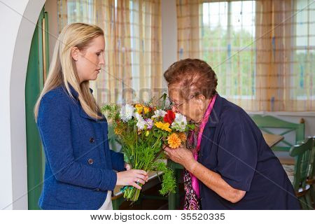 a grandson to visit his grandmother and bring flowers as a gift.