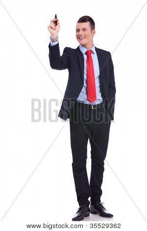full body picture of a business man writing with marker isolated on white background