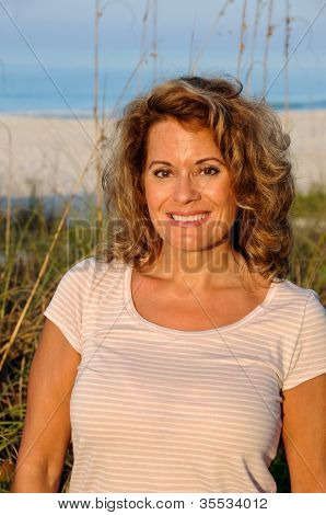 Attractive Woman At The Beach At Sunrise