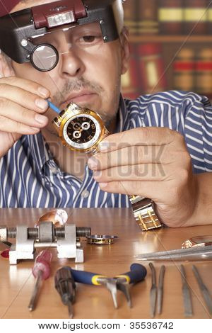 Watch repair craftsman repairing watch. Focus on watch