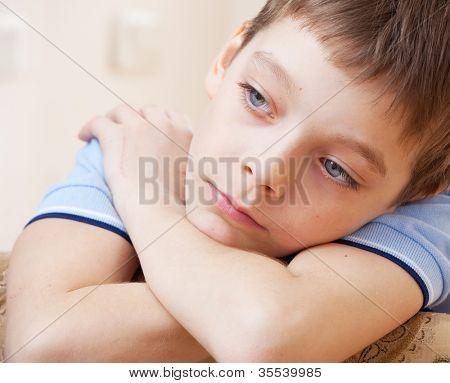 Sad boy. Depression child at home
