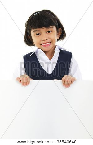 Southeast Asian schoolgirl holding a white board