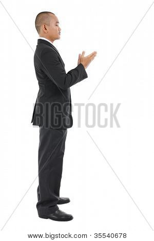 Male Muslim prayer in full business suit praying over white background
