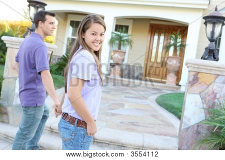 Young Couple Arriving At New Home