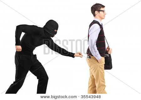 A pickpocket with mask trying to steal a wallet isolated on white background