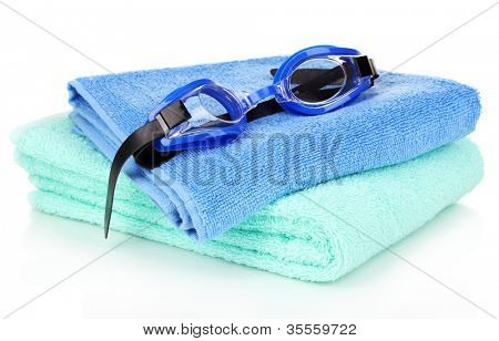 Swim goggles on towel isolated on white