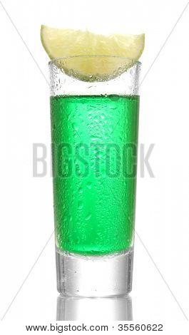 glass of absinthe and lime isolated on white