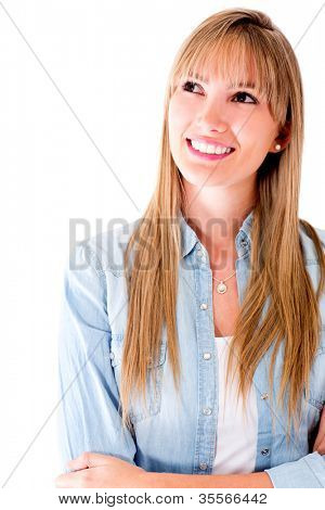 Woman daydreaming and smiling - isolated over a white background