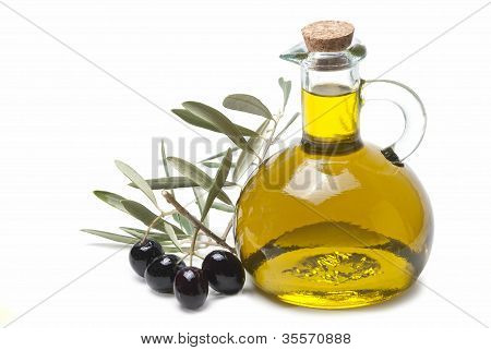 Olive Oil And A Branch With Olives.