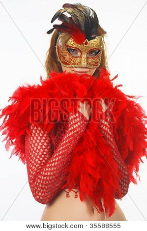 Portrait of attractive beautiful young woman wearing gold carnival mask