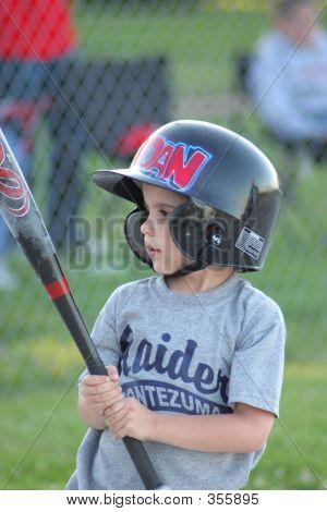 Boy Looking At Baseball Bat.