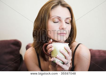 Portrait of young beautiful happy woman with tea