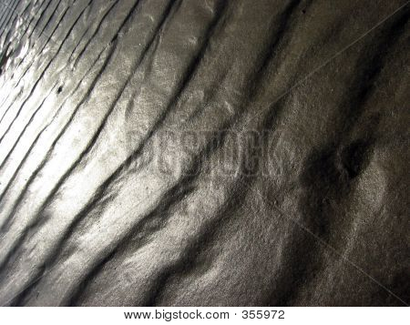 Ripples In The Sand With A Cascade Of Sunlight