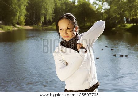 young sporty woman front of a lake