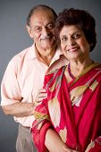 foto of married couple  - Portrait of a happy elderly East Indian couple - JPG