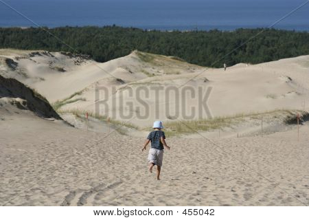 Child And Sand