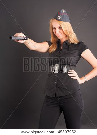 pretty girl holding a gun