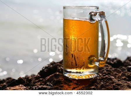 Cold Beer Cider Glass On A Cliif, Shiny Sea Background