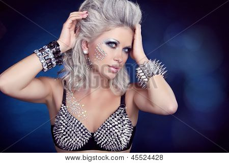 Beautiful Rock Woman With Hair Styling And Evening Make-up. Jewelry And Beauty. Fashion Art Photo. P