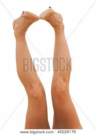 Female Legs In Tan Shoes
