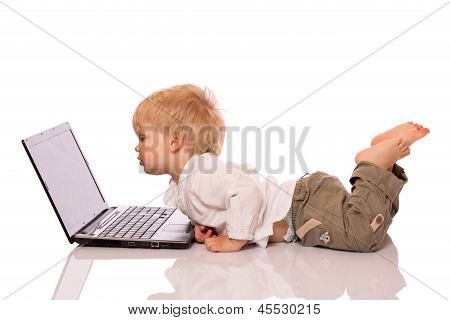 Young Boy Looking At A Laptop